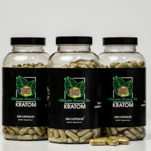set of green kratom pills sitting on table